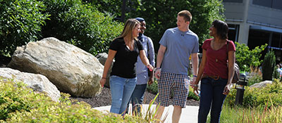 students walking across campus in summer