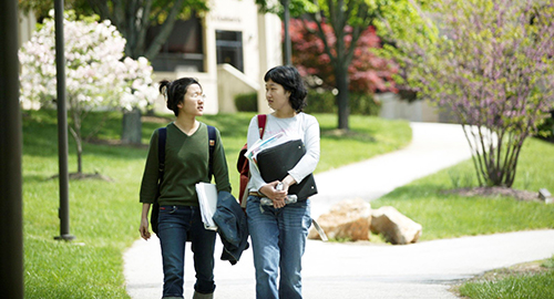 elc students walking on campus