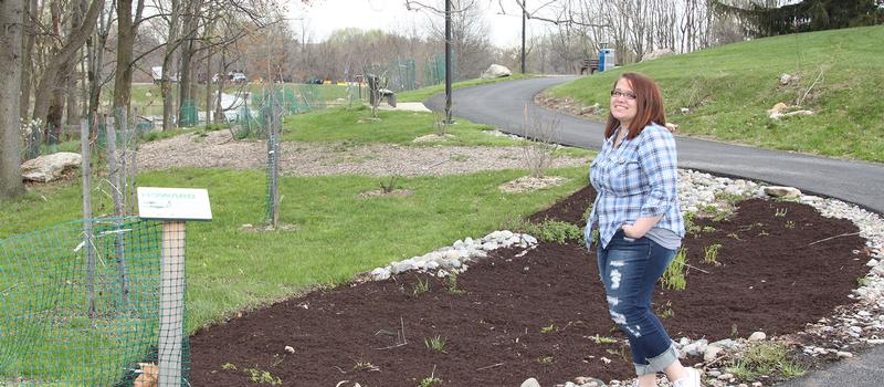 student participating in HCC's sustainability effort