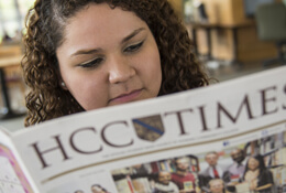 Student reading HCC times