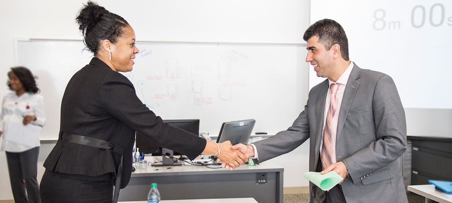 woman greeting a man in a business setting