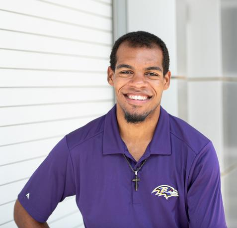 Photo of Xavier, wearing Ravens shirt, smiling