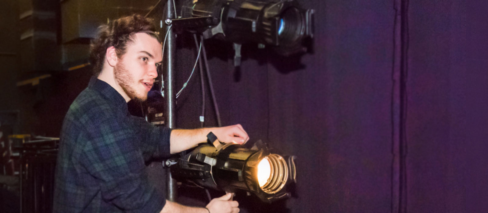 A lighting technician in the entertainment technology degree at HCC.
