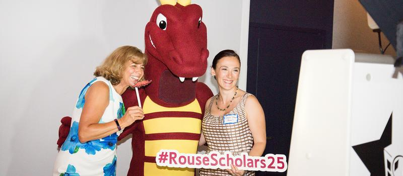 A photo of Rouse representatives with Duncan the Dragon.